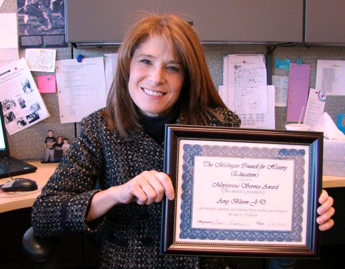 Amy Bloom, JD, with Meritorious Service Award for MC3